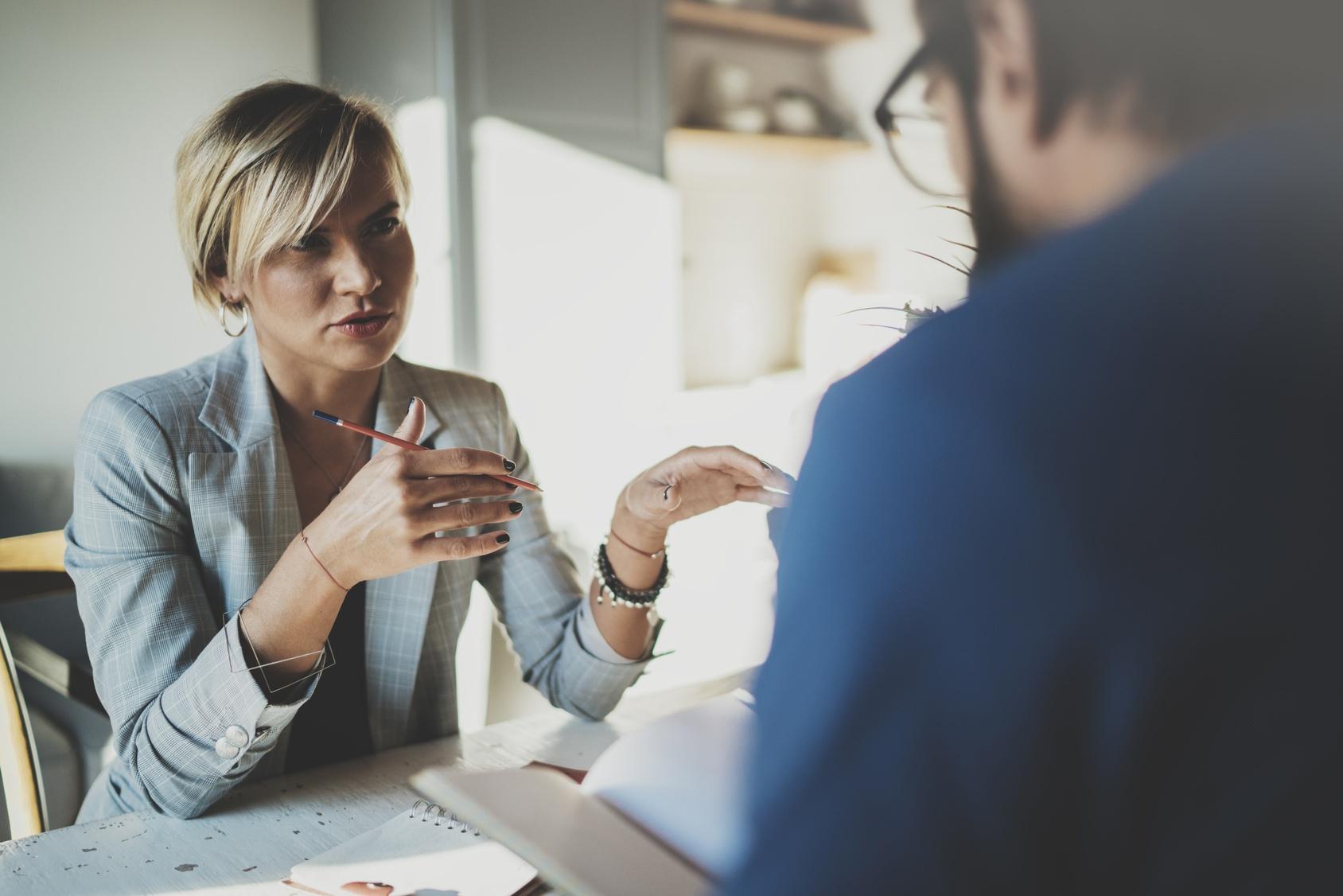 Woman using an assessment to supplement an interview
