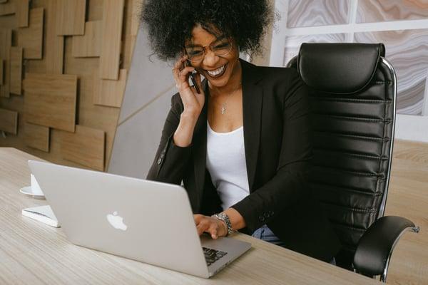 woman-in-black-blazer-sitting-on-black-office-chair-3727464-1